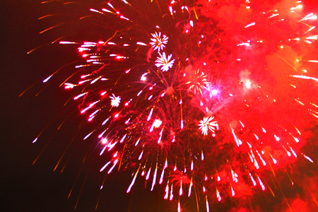 Starburst of bright red firework lights during Halloween, Christmas, Independence Day, New Year. Zdjęcie Seryjne