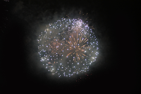 Star cloud of bright yellow and green fireworks lights during Halloween, Christmas, Independence Day, New Year. Zdjęcie Seryjne