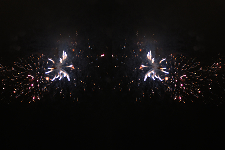 The star dust of bright white firework lights. during Halloween, Christmas, Independence Day, New Year.