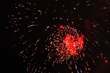 Star dust-scattering of bright yellow and red firework lights. during Halloween, Christmas, Independence Day, New Year.