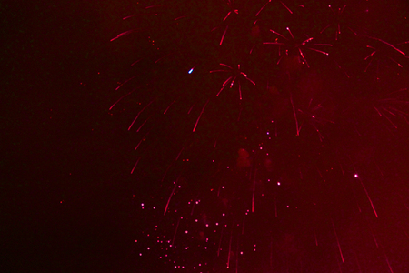 Starry song of bright red firework lights during Halloween, Christmas, Independence Day, New Year. Zdjęcie Seryjne
