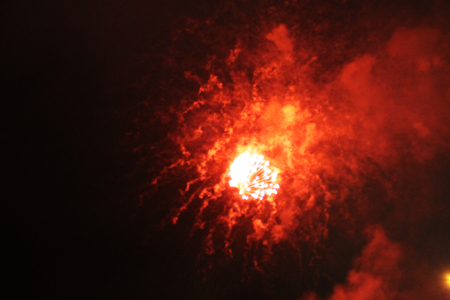 Star flash and a scattering of bright yellow and red firework lights. during Halloween, Christmas, Independence Day, New Year.