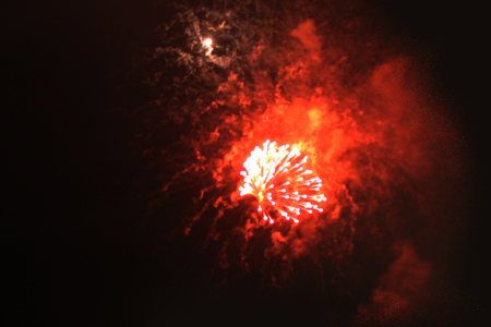 A beautiful flash of bright gold and red shiny firework lights. during Halloween, Christmas, Independence Day, New Year.