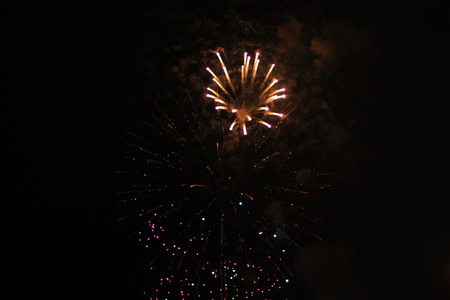 Beautiful placer bright yellow shiny lights of fireworks during Halloween, Christmas, Independence Day, New Year.