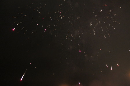 Twinkling bright purple sparkling firework lights. during Halloween, Christmas, Independence Day, New Year.