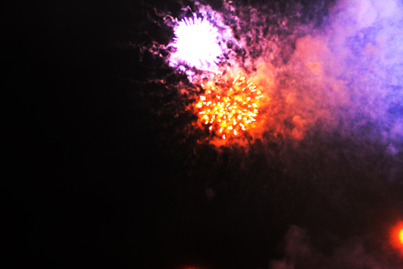 The fog of bright red and purple shiny lights of fireworks. during Halloween, Christmas, Independence Day, New Year.