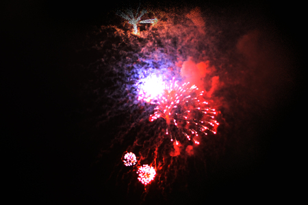A beautiful placer of bright red and purple sparkling firework sparks. during Halloween, Christmas, Independence Day, New Year.
