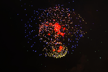 Beautiful ball-scattering of bright red and violet brilliant sparks of fireworks. during Halloween, Christmas, Independence Day, New Year.