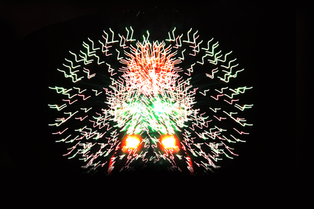 Halloween, Christmas, Independence Day, New Year. Bright festive fireworks of different colors fire in the form of a pyramid