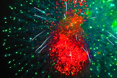 nflorescence of bright green and red firework lights. Halloween, Christmas, Independence Day, New Year.