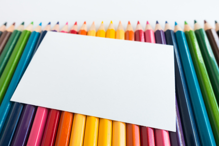 Note paper on Colour pencils background