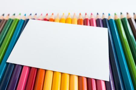 postit: Note paper on Colour pencils background