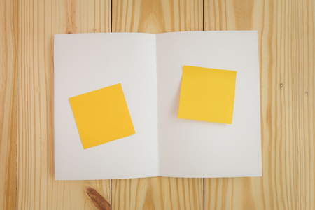 Blank white template paper on wood background with soft shadows. Ready for your design