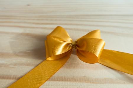 Ribbon Bow on wood background Banco de Imagens