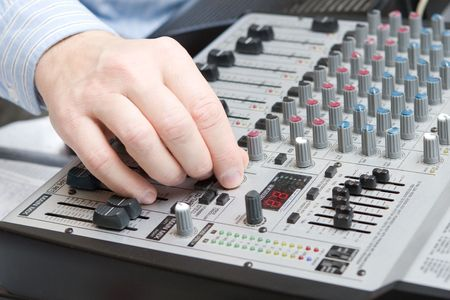 hand adjusts setting on the board of a synthesizer Stock Photo - 3009126