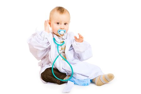 boy of one year old in white gown of doctor with stethoscope photo