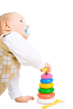 developing: The toddler boy plays developing game. Color pyramidion. Stock Photo