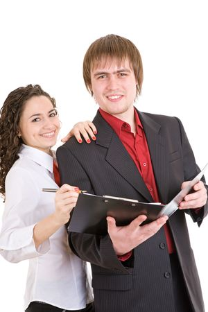 businesswear: smiling man and woman dressed for office stand with a carpet