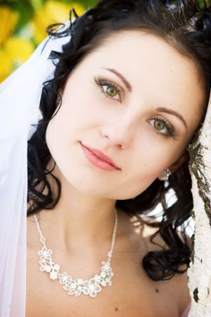 a portret of the thinking bride near the birch photo