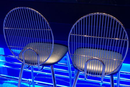 chrome seats with blue neon glow photo