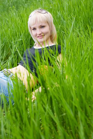 young girl rest in the green meadow photo