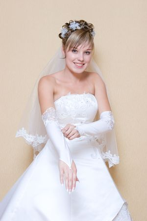 beautiful bride puts on a long white glove