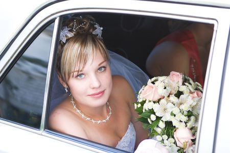 young bride in the car photo