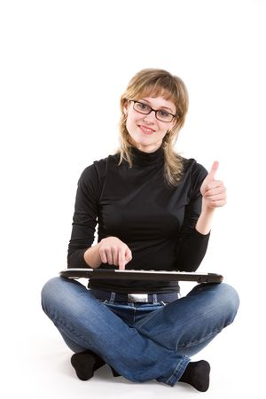 a smiling girl with a keyboard shows that everything is good Stock Photo - 3039028