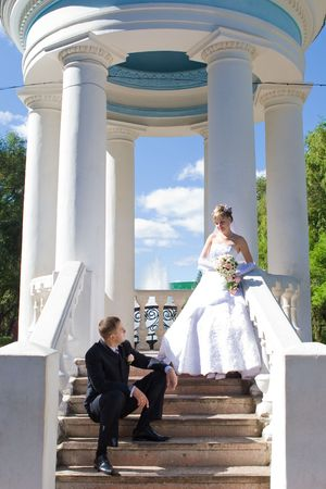 bride and groom in a opened house with columns Stock Photo - 3066951
