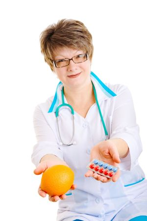 stethoskope: doctor with medcine in one hand and orange in another