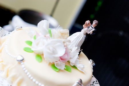 wedding cake decorated with figures of people