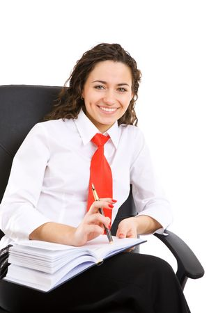 businesswoman seat in armchair and holds pen and book photo
