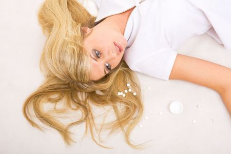 beautiful dead girl with tablets on the floor photo