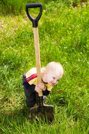 small girl ready to work in the garden Stock Photo
