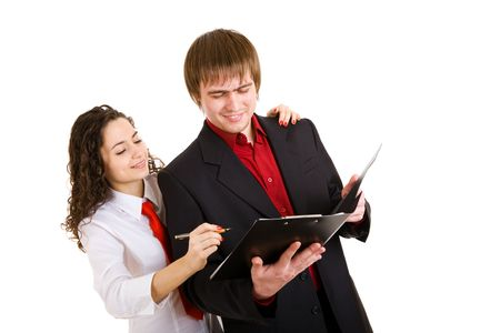 businessman and girl write papers photo