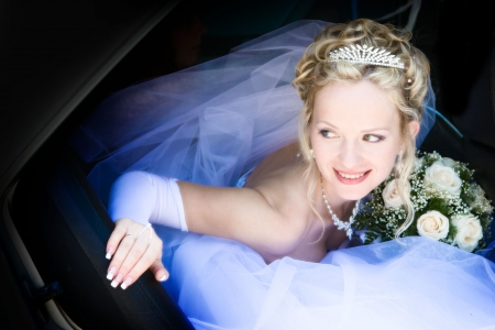 Portrait of the bride sitting in the car Stock Photo