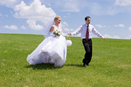 bride and groom are walking in the park Stock Photo - 3120714