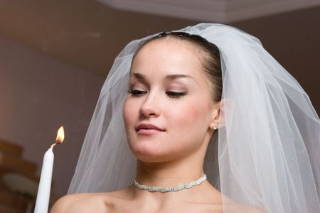 bride with a birning candle photo
