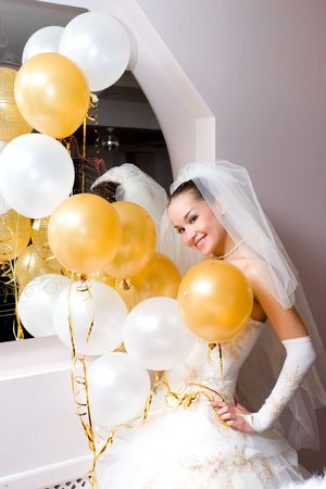 pretty bride and white and golden balloons