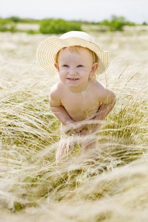 small girl in feather-grass photo