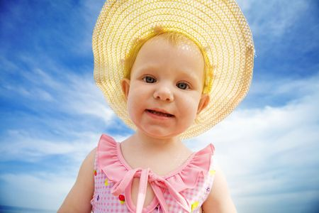 portrait of the small girl in straw hat photo