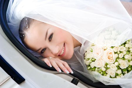 bride looks out of the car Stock Photo