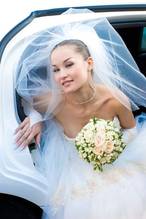 bride goes out of the wedding car