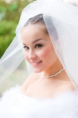 portrait of the happy bride outdoors Stock Photo