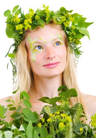 blond girl in green leaves photo