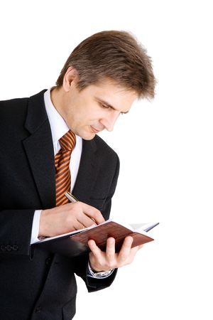 businessman writing something in his notebook Stock Photo - 3159408
