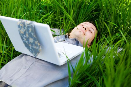 businessman rest on the grass with laptop Stock Photo - 3159479