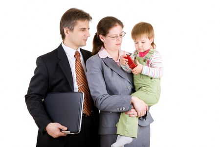 father and mother dressed for business with child photo