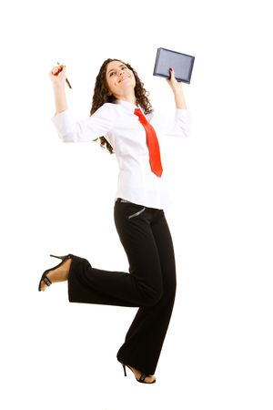 smiling businesswoman jumps with a pan and a book photo