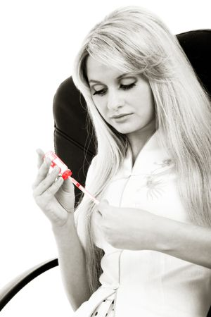black and white image of the girl wit syringe in red Stock Photo - 3219839